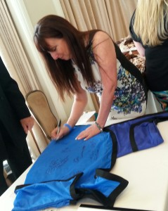 Media Personality Karen Salkin signing the Rein Coat for charity. Photo by Alice Farinas.