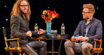 Tim MInchin being interviewed on stage by Barrett Foa.