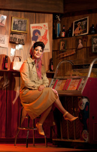 Cori Cable Kidder as Patsy Cline, sitting in yet another area of the fabulous set. Photo by Gina Long.