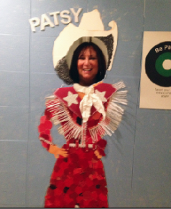 "There's a fun, appropriate exhibit in the lobby, which includes this ""Patsy"" cut-out. Doesn't INAM's Karen Salkin look happy to stick her head out of it?  Photo by Alice Farinas."