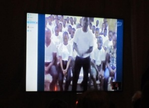 The video chat with the children in Ghana, on the big screen in the banquet room.  Photo by Alice Farinas.