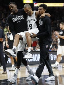 Tony Parker being carried off the court by his teammates.