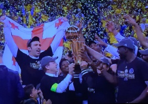 As you can see, Kevin Durnat's mother pushed her way to the front of the celebration on stage.  The team (and the woners and coaches) should have been the only ones to hoist the trophy, not someone's MOM, for goodness' sake!!! Photo by Karen Salkin.
