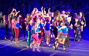 The fun closing number.  Laurie Hernandez is on the front right, with the little girl on her back. Photo by Karen Salkin.