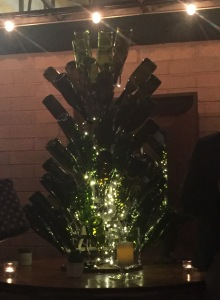 An interesting decoration on the patio--a Xmas tree made out of empty wine bottles! Photo by Karen Salkin.