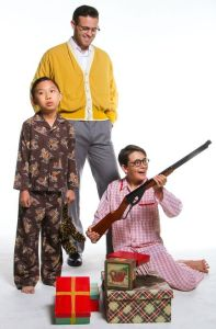 (L-R) Kevin Ying, Jackson Kendall, (as the grown-up Ralphie,) and Griffin Sanford.  (You know that I'm totally against firearms in life, but this one is comedically central to the story.)  Photo by John Dlugolecki.