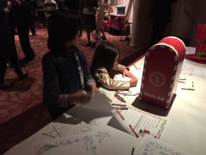 Benjie and Alexa writing their letters to Santa.  I hope they put in a good word for me!  Photo by Karen Salkin.