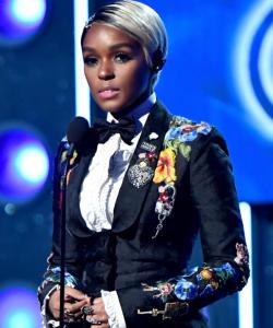 Janelle Monae, in NOT just black and white!  (Except for her hair, of course.)