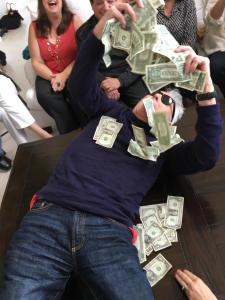 Mr. X throwing himself into his winnings!  Photo by Karen Salkin.