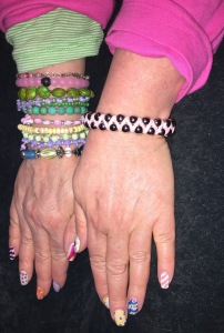 Karen Salkin's very colorful clothing and jewelry and Easter e-word nails that...she painted herself!!! Photo by Mr. X.