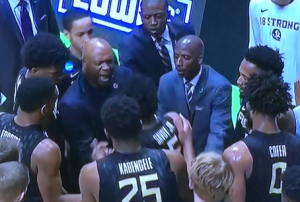 Evil FSU Coach Leonard Hamilton in the middle, screaming at his player whose jersey he's still grabbing!  And the whole scene was so much worse than just this screen grab shows. Photo by Karen Salkin.