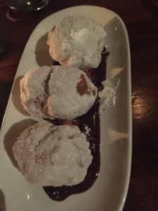 The Buttermilk Zeppole.  They didn't look this unappetizing in person (but close.) It's just so dark in Sotto that all my pix came out like this.  Photo by Karen Salkin.