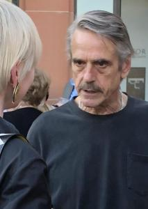 Jeremy Irons at the opening night after-party, chatting intensely with the best-dressed woman there. Photo by Mr. X.