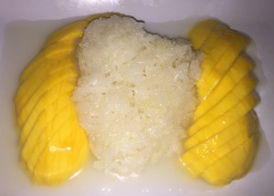 Mango Sticky Rice. (I love that the rice is sort-of in the shape of a heart.  Or a matzoh ball!!!)  Photo by Karen Salkin.