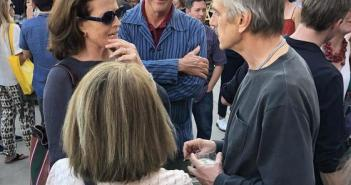 Sigourney Weaver and Jeremy Irons deep in conversation, with an interloper on each side of them!  Photo by Mr. X.