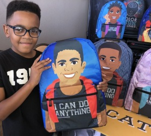 Carter Kelley with the backpack designed with his image!  Photo by Karen Salkin.