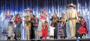 The professional performers dancing with children from the audience.  Photo by Karen Salkin.