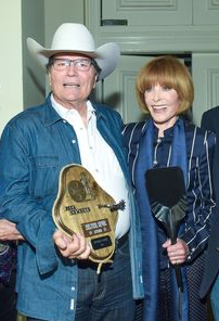 Patrick Wayne and Stefanie Powers. Photo by William Kidston.