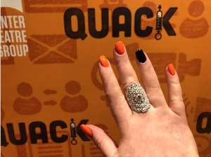 I thought this is a good place to show you that my Halloween nails matched Quacks' bannera and program!  Photo of Karen Salkin's hand by...Karen Salkin's other hand!