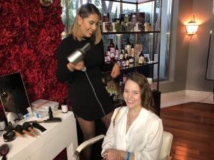 Alie Hernandez working on Nina Herzog's hair. Photo by Karen Salkin.