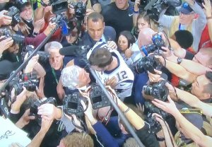 Finding Tracy Wolfson in this pic is like doing Where's Waldo?!  She's the tiny woman being squished behind Tom Brady, who knew she was there, but did nothing to help her!  Photo by Karen Salkin.