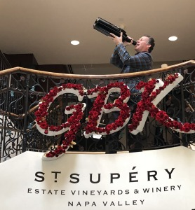 Gavin Keilly, CEO of GBK Productions, humorously showcasing a giant bottle of St. Supéry wine. Photo by Karen Salkin.