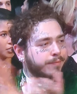 Post Malone, keeping it classy with that cigarette behind his ear!   Photo by Karen Salkin.
