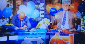 (L-R) Kenny Smith being miserable that his UNC Tar Heels (the agony of defeat)  just lost to Charles Barkley's Auburn Tigers (the thrill of victory.) Photo by Karen Salkin,