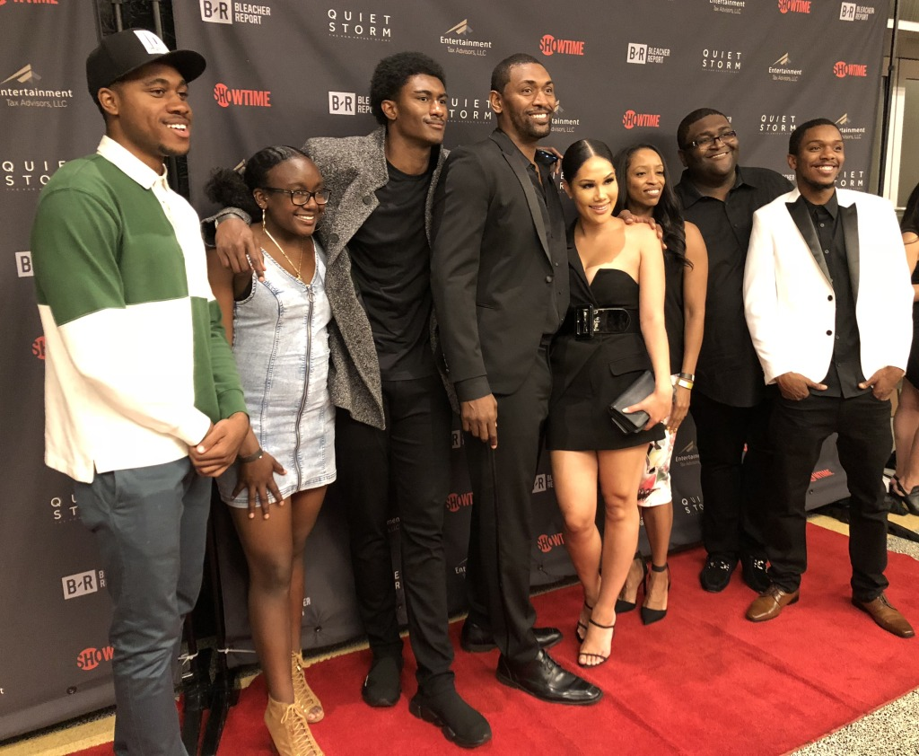 Ron Artest in the middle, flanked immediately to both sides by his son and wife, his daughter next to his son, and then assorted other family members.  Nice-looking clan, right? Photo by Karen Salkin.