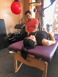 Justin doing a massage. Photo by Karen Salkin.