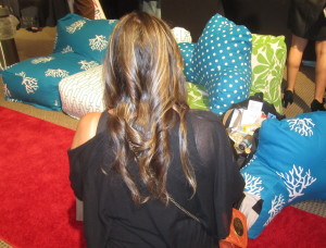Rachel's newly curled hair, in front of the fabulous Majestic Home Goods pillows. Photo by Karen Salkin.
