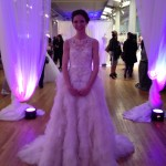 A wedding dress being modeled, as we entered the floor.  Photo by Sharon Lieberman.