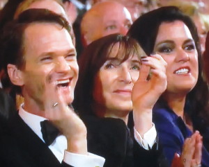 Rosie O'Donnell trying to smile though Lena Hall's awful speech, even though NPH seems to be enjoying it. Photo by Karen Salkin.