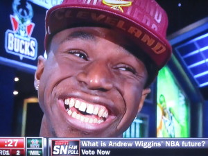 I really like this guy, but I'm so happy that now #1 draft pick Andrew Wiggins can get braces.  Photo by Karen Salkin, of course!  (Who else would take a snap like this?)