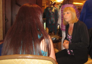 Gloria Layne Bieber doing an aura reading on a guest. Photo by Alice Farinas.