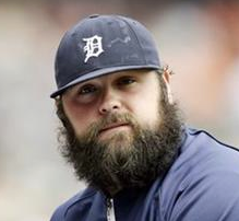 Joba Chamberlain and his nauseating beard.  And dirty cap!  Believe it or not, this is far from the worst picture I could find of him, but I didn't want to foist the others on unsuspecting you!