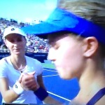 Eugenie Bouchard, on the right, giving one of the coldest handshakes I've ever witnessed to the girl who beat her, Ekaterina Makarova. She wouldn't even look at the victor!  Photo by Karen Salkin.