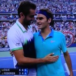"""Roger Federer, on the right, telling Marin Cilic, who just beat him in the semi-final, """"I'm happy for you,"""" and meaning it!  What a man!   Photo by Karen Salkin."""
