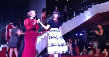 Designer Bri Seeley, on the right, taking her bow at the end of her segment of the show.  Photo courtesy of Mannfolk PR.