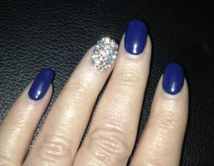 Nay Ching did the blinged-out nail, which looks even a zillion times better in person.  And the crystals  haven't moved at all in over a week and a half!!!  Photo by Karen Salkin.
