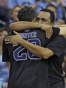 An emotional Ron Hunter, embracing his son, after what is most likely RJ's last college game.