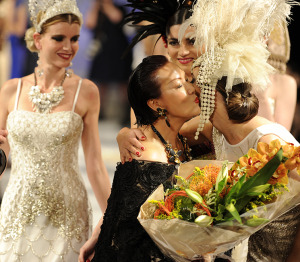 Designer Extraordinaire, Sue Wong, in the middle, being lauded by her models.  Photo by Arun Nevader.