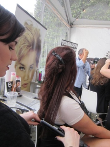 Karen Salkin's gorgeous auburn tresses being seriously flat-ironed by Faith. Photo by Alice Farinas.