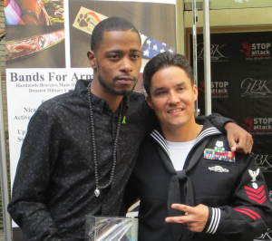 Keith Stanfield with a navy  guy from Bands For Arms. Photo by Alice Rarinas.