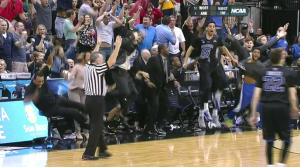 Ron Hunter, on the left,  falling off his stool when son RJ, (on the very right) hit the game-winning shot.
