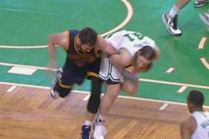Kevin Love's arm being pulled by Kelly Olynyk.
