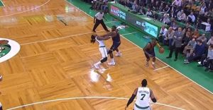 Kendrick Perkins, in blue, choking Jae Crowder, in white, and throwing him to the Celtics' famous parquet floor.