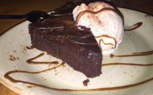 The tasteless chocolate cake. Notice all the sauce!