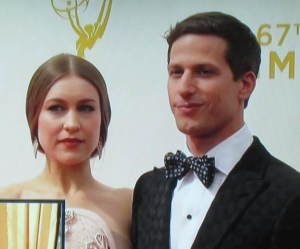 The woman with Andy Samberg. (The box in front is an insert they were showing.) Photo by Karen Salkin.
