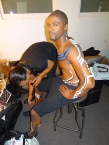 "Lamonte Goode, getting his ""warpaint"" on backstage. Photo by Lauren Bennett."